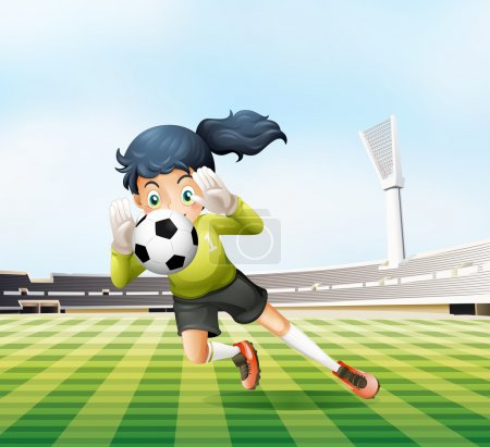 A female player catching the soccer ball