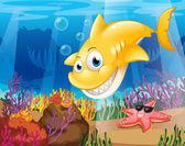 žlutý žralok pod mořem s hvězdicemi a korály