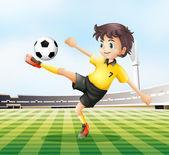 A football player kicking the ball