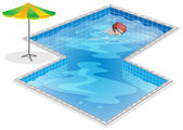 A boy practicing at the swimming pool