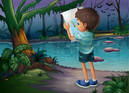 A boy with a map standing in the middle of the forest