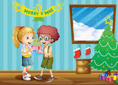 Two adorable kids exchanging their christmas gifts