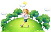 Dívka běží nad kopci