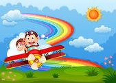 Letadla s dvěma vychloubačný opice a duha na obloze