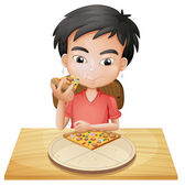 A boy eating pizza