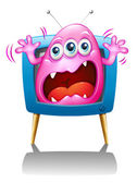 A TV with a pink monster screaming