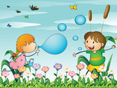 Kids at the garden playing with the blowing bubbles