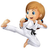 A young girl doing karate