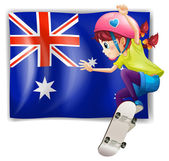 A girl skateboarding in front of the Australian flag
