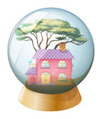 A crystal ball with a beautiful house inside