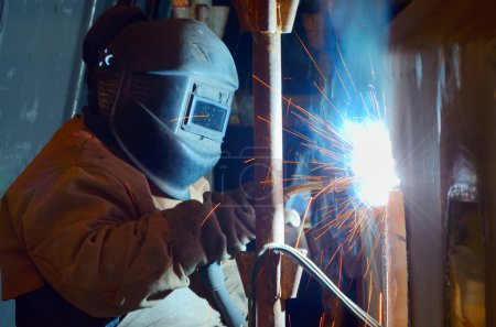 a welder working at shipyard