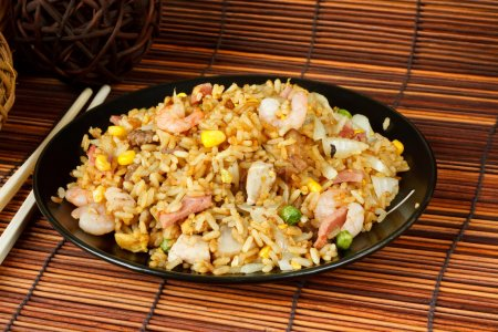 Photo for Special fried rice a popular oriental dish available at chinese take aways - Royalty Free Image