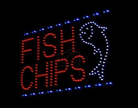Photo for Fish and chips LED sign at take away or fast food restaurant - Royalty Free Image