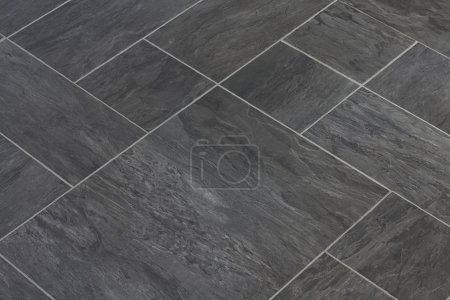 Photo for Slate texture vinyl flooring a popular choice for modern kitchens and bathrooms - Royalty Free Image