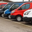 Row of different marques of commercial vehicles or...