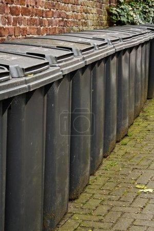 Row of residential wheelie bins