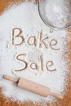 Photo for Flour on a wooden table symbolising a Bake Sale Notice - Royalty Free Image