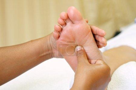 Reflexology foot massage, spa foot
