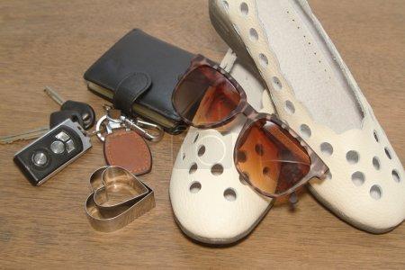 Carkeys , sunglasses,shoes with pocket money,Ready to travel