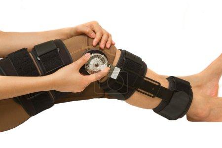 Photo pour Angle réglable de genouillère de renfort pour blessure de la jambe ou genou - image libre de droit