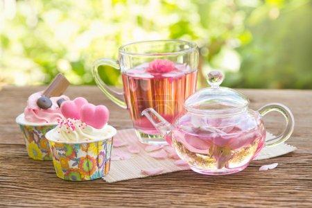 Afternoon tea breake, rose tea with tea pot in the garden