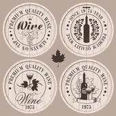 Four labels for wine on wooden casks