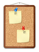 Blank note papers on cork board