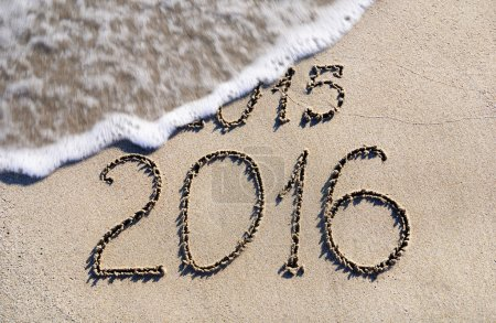 Photo for Happy New Year 2016 replace 2015 concept on the sea beach - Royalty Free Image
