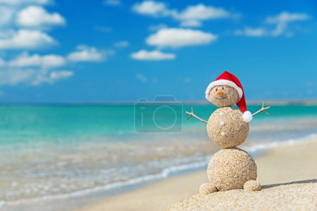 Sandy snowman in santa hat. Holiday concept for New Years and Ch