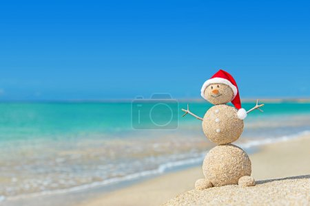 Sandy snowman in santa hat.