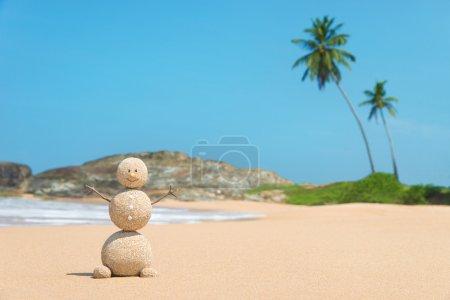 Sandy man at ocean beach