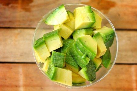 Photo for Avocado fruit on wood background - Royalty Free Image
