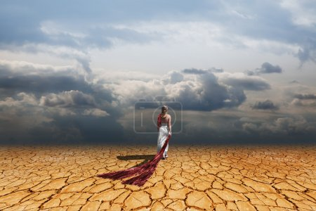 Photo for Girl walking on dry land - Royalty Free Image