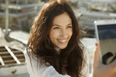 Smiling girl take a picture, selfie style