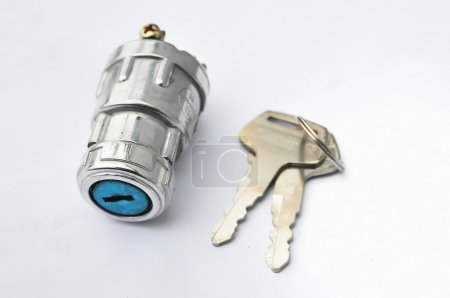 Electronic ignition lock with keys on an isolated background