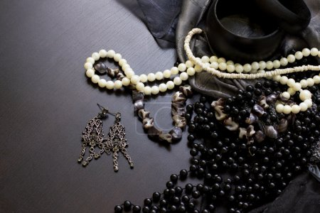 Photo for Pearl necklace and earrings on the black table - Royalty Free Image