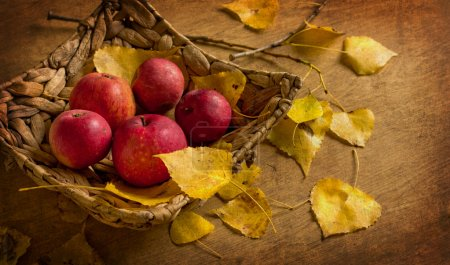 Red apples with basket