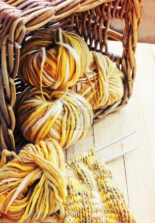 Photo for Vintage knitting needles and yarn in basket - Royalty Free Image