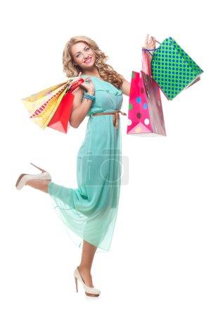Blond girl holding shopping bags