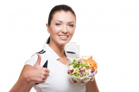 Photo for Beautiful sporty healthy woman with mixed salad over white background - Royalty Free Image