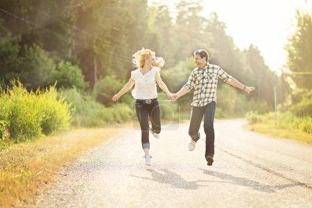 Happy couple running