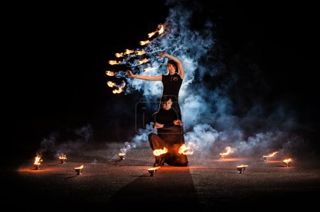 Photo for Spectacular fire show with fire dancers - Royalty Free Image