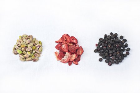 Photo for Pistachios, frozen dried strawberries and blueberries prepped for baking. - Royalty Free Image