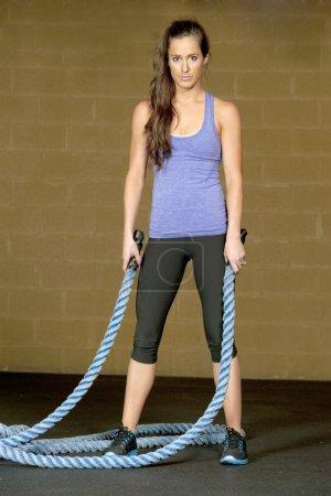 Woman training with atheltic training ropes