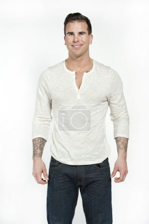 White Male in White T-Shirt And Jeans