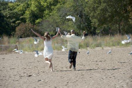 Interracial couple on the beach