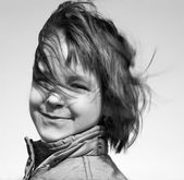 Portrait of little girl in the wind