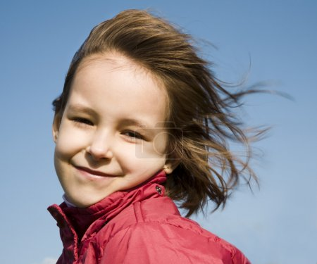 Little girl in wind