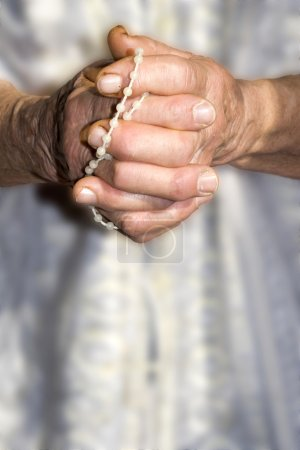 Hands of old woman at prayer