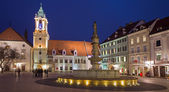BRATISLAVA, SLOVAKIA - JANUARY 23, 2014: Main square in evening dusk with the town hall and Jesuits church.
